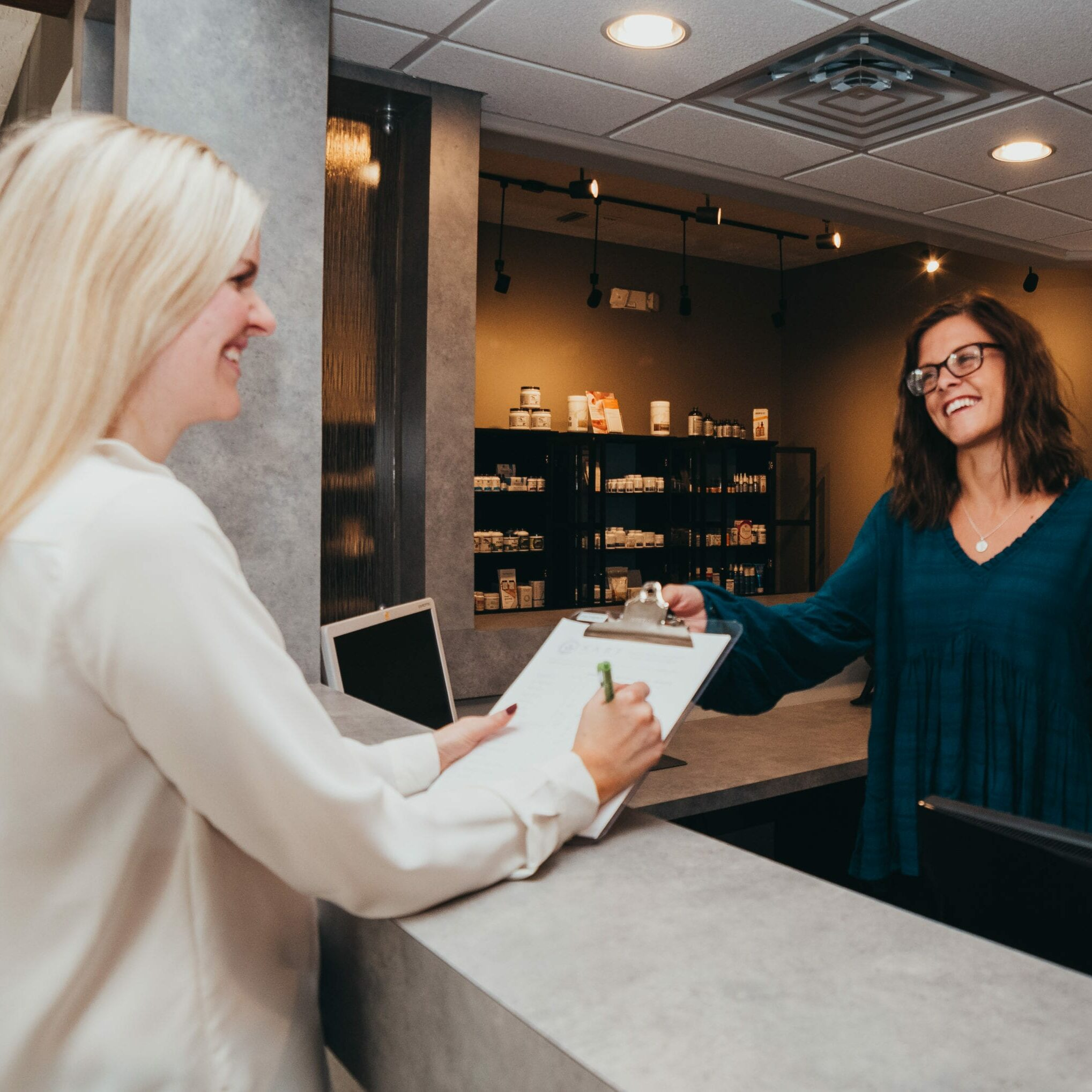 Become A Kare Patient Integrative Wellness in Springfield Missouri - Talking At Front Desk